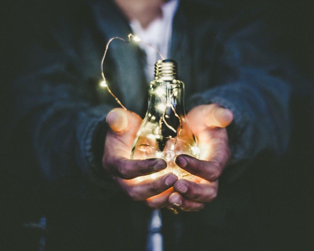 man-holding-lightbulb